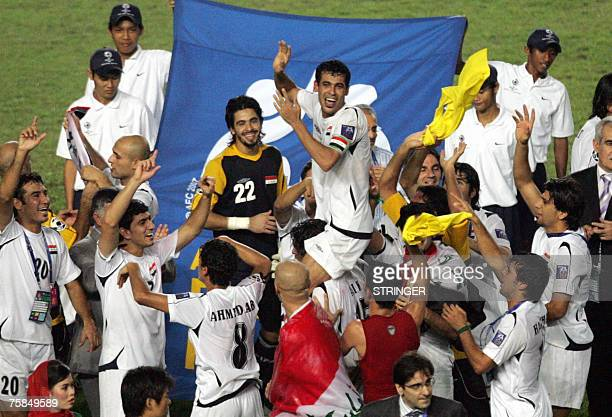 Iraq's players celebrate their victory over Saudi Arabia at the end of the final match of the Asian Football Cup 2007 at the Bung Karno stadium in...