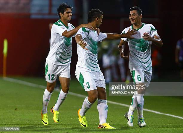 Iraq's players Mohammed Jabbar Arebat Ali Adnan and Saif Salman celebrate after scoring a goal against Uruguay during their semi final football match...