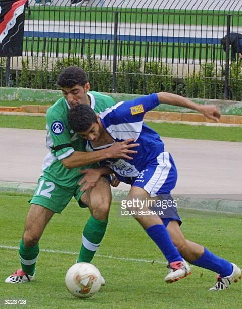 Iraq's Police Club or al-Shorta player Farid Ghadban vies for the ball against Saudi Arabia's al-Hilal club player Ahmed al-Jaber during their Asian...