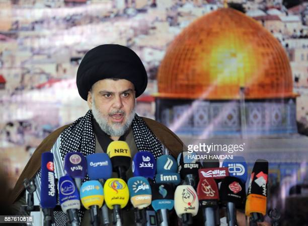 Iraq's powerful Shiite cleric Moqtada alSadr addresses the media with a giant photo of Jerusalem's Dome of the Rock mosque in the background in the...