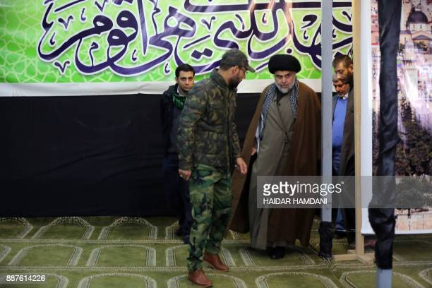 Iraq's powerful Shiite cleric Moqtada alSadr arrives to address the media in the shrine city of Najaf in central Iraq on December 7 2017 to denounce...