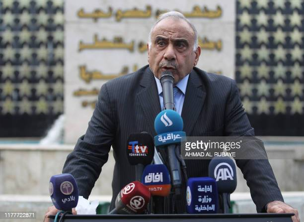 Iraq's Prime Minister Adel Abdel Mahdi speaks during a symbolic funeral ceremony in Baghdad on October 23 2019 for Major General Ali alLami a...