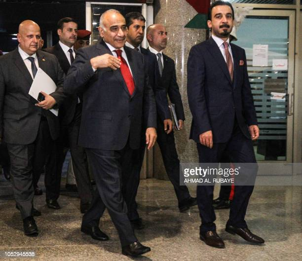 Iraq's prime minister designate Adel Abdel Mahdi arrives with parliament speaker Mohamhed Halbusi at the parliament headquarters in the capital...