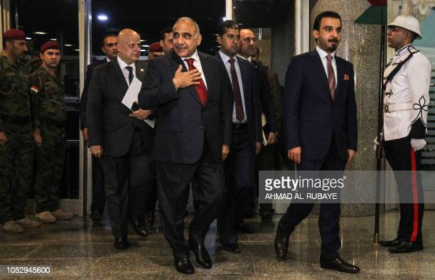 Iraq's prime minister designate Adel Abdel Mahdi arrives with parliament speaker Mohamed Halbusi at the parliament headquarters in the capital...