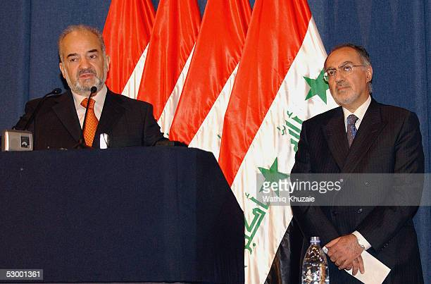 Iraq's Prime Minister Ibrahim alJaafari speaks to reporters at a press conference as Iraq's Minister of Finance Ali AbdelAmir Allawi looks on May 31...