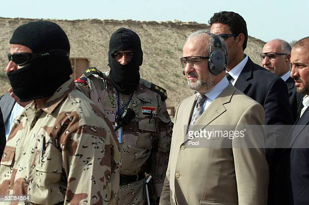 Iraq's Prime Minister Ibrahim alJaafari watches Iraqi special forces shoot at targets at a training base at Baghdad airport on July 25 in Baghdad...