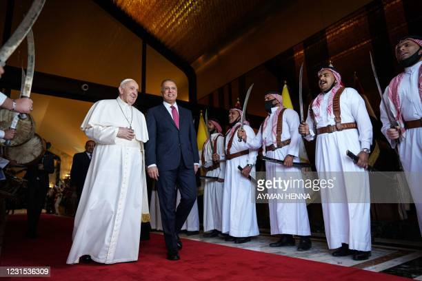 Iraq's Prime Minister Mustafa al-Kadhemi welcomes Pope Francis at Baghdad International Airport's VIP Lounge, on March 5, 2021. - Pope Francis landed...