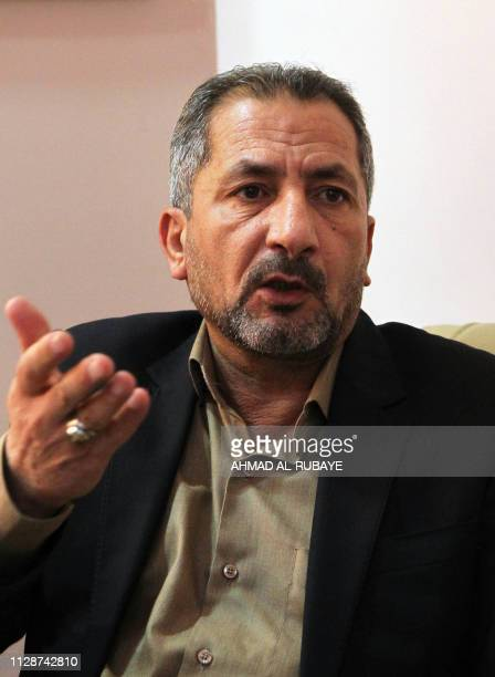 Iraq's spokesman for the Hezbollah Brigades Mohammed Mohie gestures in his office in Baghdad on February 5 2019