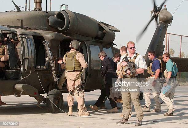 Iraqs US administrator Paul Bremer boards a helicopter in the Iraqi city of Hillah June 17 2004 Iraq Mr Bremer has met CPA officials as well as...