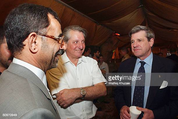 Iraqs US administrator Paul Bremer meets the governor of the Iraqi province of Muthana Mr Mohamed Ali alHassani in a large tent at the Dutch military...