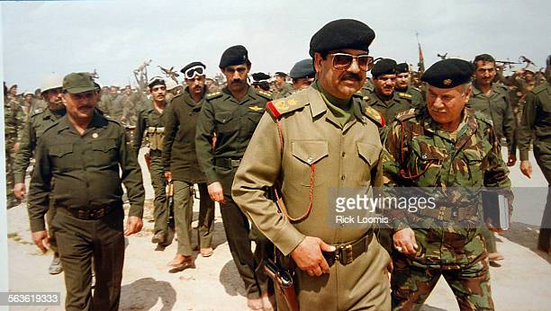 Iraq––Saddam Hussein with his military in a photograph from a large archive inside the Presidential Palace complex Copy photo of photograph found in...