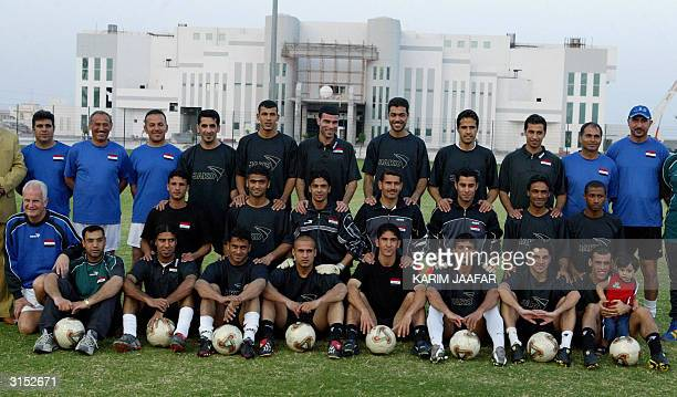 Iraqy players of the national soccer team pose 29 March 2004 for a picture at the alIttihad stadium in Doha during a training session in preparation...