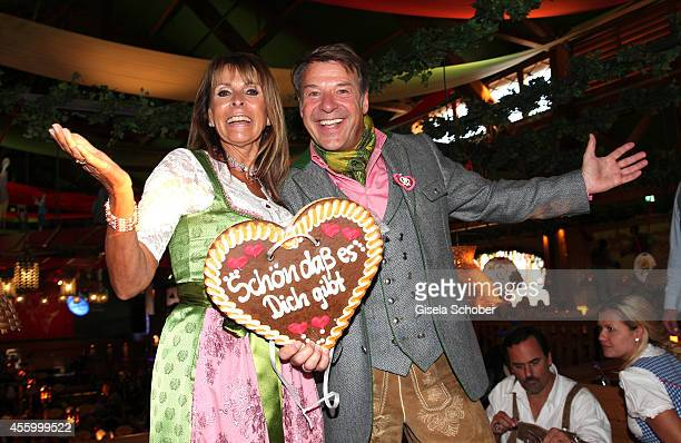 Ireen Sheer and Patrick Lindner attend the 'GoldStar TV Wiesn' during Oktoberfest at Weinzelt Theresienwiese on September 23 2014 in Munich Germany