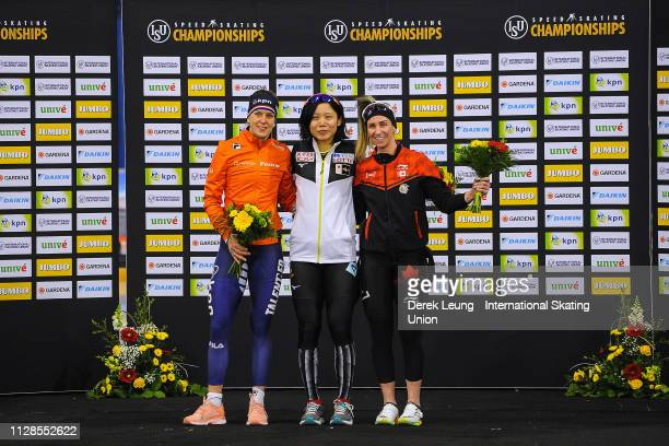 Ireen Wüst Miho Takagi and Ivanie Blondin stand on the podium after placing in the ladies 1500m during the ISU World Allround Speed Skating...