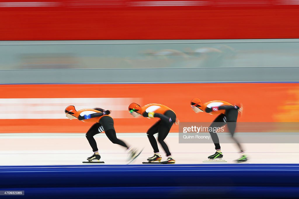 Ireen Wust, Lotte van Beek and Jorien ter Mors of the Netherlands compete during the Women's Team Pursuit Quarterfinals Speed Skating event on day fourteen of the Sochi 2014 Winter Olympics at Adler Arena Skating Center on February 21, 2014 in Sochi, Russia.