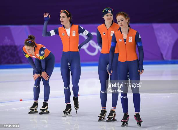 Ireen Wust Marrit Leenstra Lotte Van Beek and Antoinette De Jong of the Netherlands react after being defeated by Japan in the gold medal race during...
