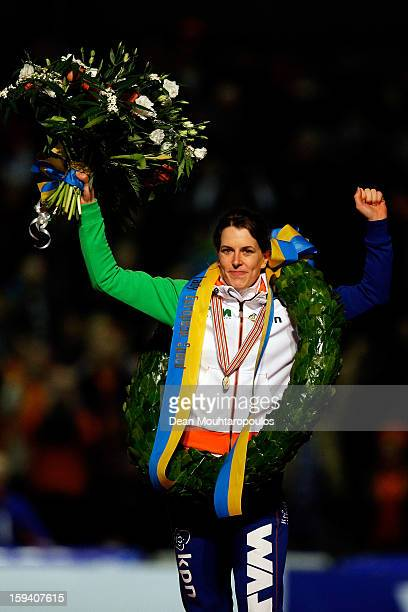 Ireen Wust of Netherlands celebrates becoming the European Champion with her medal wreath and flowers during the Final Day of the Essent ISU European...