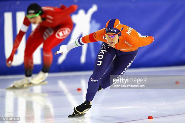Ireen Wust of the Netherlands and Hege Bokko of Norway compete in the 1000m Ladies race on Day Three of the Speed Skating ISU World Cup on December...