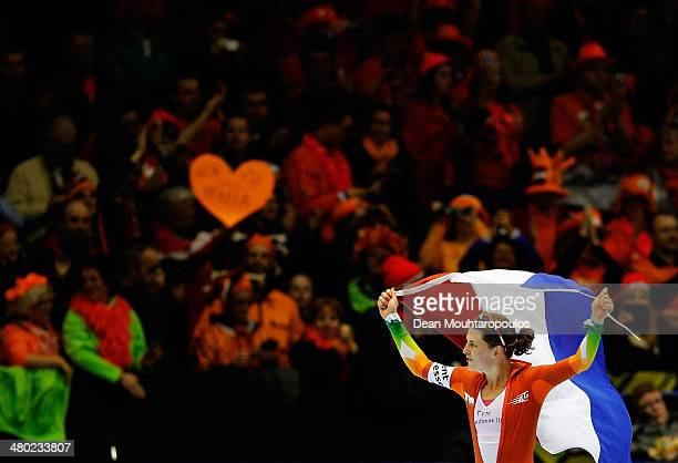 Ireen Wust of The Netherlands celebrates with the fans after she competes in the 5000m Ladies Race and wins the overall competition during day two of...