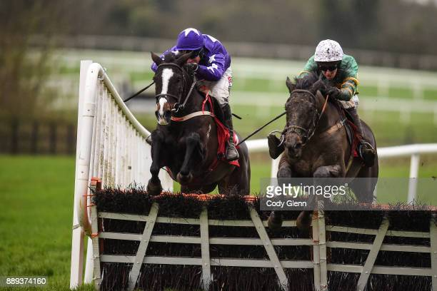 NAAS Ireland 10 December 2017 Aa Bee See with Mark Walsh up jump the last ahead of Mary Frances with Robbie Power up on their way to winning the 3...