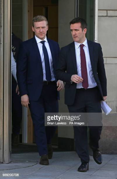 Ireland and Ulster rugby player Stuart Olding and his solicitor Paul Dougan leave Belfast Crown Court after he was found not guilty of raping a woman...