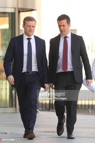 Ireland and Ulster rugby player Stuart Olding and his solicitor Paul Dougan leave Belfast Crown Court after he has been found not guilty of raping a...