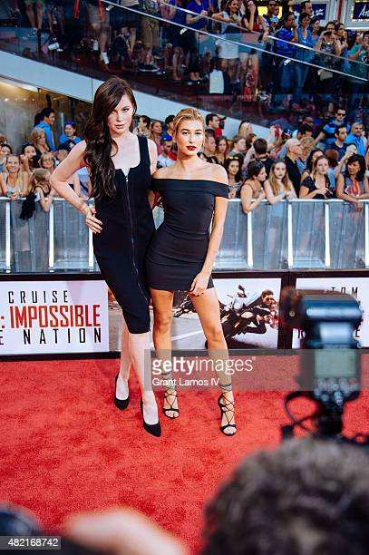 Ireland Baldwin and Hailey Baldwin attend the Mission Impossible Rogue Nation New York Premiere at Duffy Square in Times Square on July 27 2015 in...