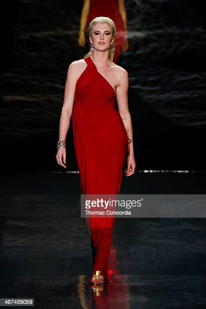 Ireland Baldwin walks the runway wearing Donna Karan at Heart Truth Red Dress Collection during MercedesBenz Fashion Week Fall 2014 at The Theatre at...