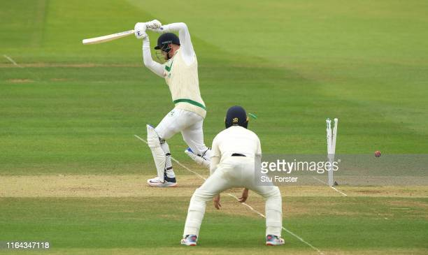Ireland batsman Mark Adair is bowled by Stuart Broad during day three of the Specsavers Test Match between England and Ireland at Lord's Cricket...