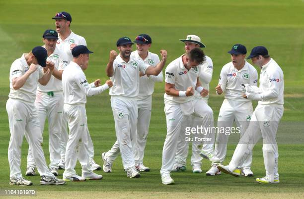 Ireland bowler Mark Adair and team mates celebrate after the review decision gives Jonny Bairstow out during day two of the Specsavers Test Match...