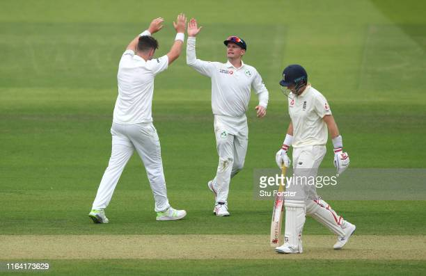 Ireland bowler Mark Adair celebrates with captain William Porterfield after dismissing England batsman Joe Root during day two of the Specsavers Test...