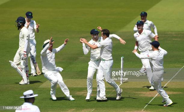 Ireland bowler Tim Murtagh celebrates with team mates after dismissing Moeen Ali to give him his 5th wicket during day one of the Specsavers Test...