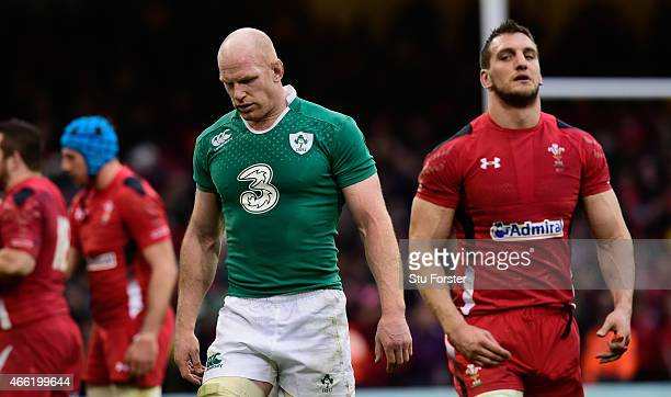 Ireland captain Paul O' Conell leaves the field dejectedly as Wales captain Sam Warburton looks on after the RBS Six Nations match between Wales and...