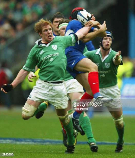Ireland captain Paul O'Connell is outjumped by Vincent Clerc of France during the RBS 2004 Six Nations match between France and Ireland at Stade...