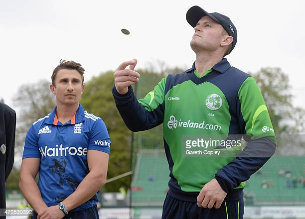 Ireland captain William Porterfield tosses the coin alongside England captain James Taylor ahead of the Royal London One Day International between...