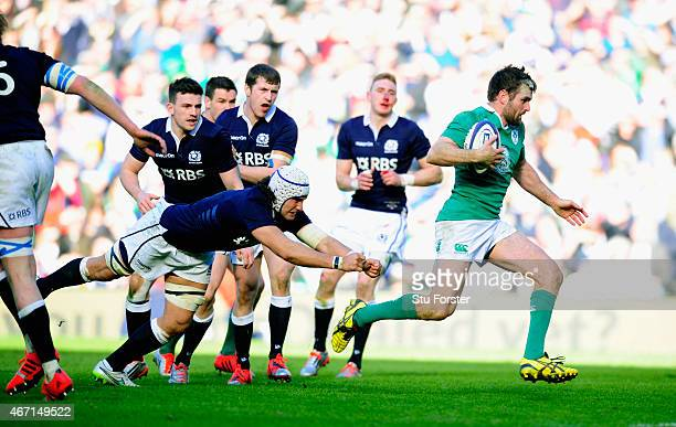 Ireland centre Jared Payne races through to score during the RBS Six Nations match between Scotland and Ireland at Murrayfield Stadium on March 21...