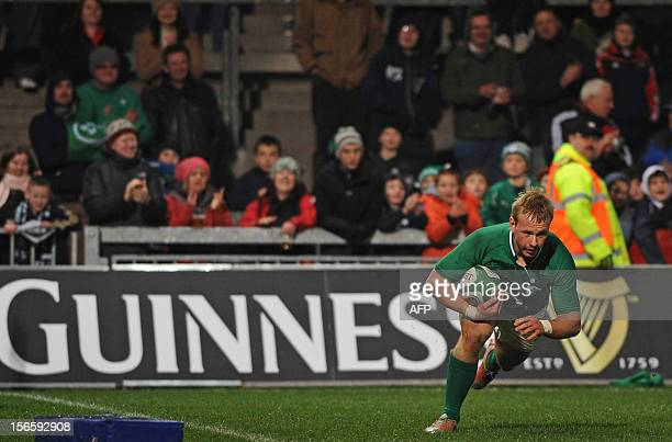 Ireland centre Luke Marshall scores a try during the International rugby union match between an Ireland XV and Fiji at Thomond Park in Limerick,...