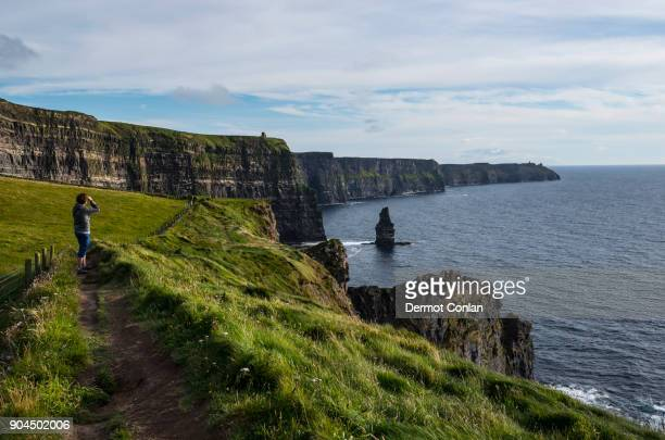 Ireland, Clare County, Woman looking at view on Cliffs of Moher