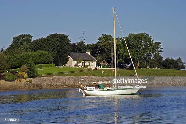 Ireland Clare Kinvara Irish cottage with boat on mooring