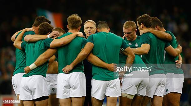 Ireland coach Joe Schmidt chats with his players before the 2015 Rugby World Cup Quarter Final match between Ireland and Argentina at Millennium...