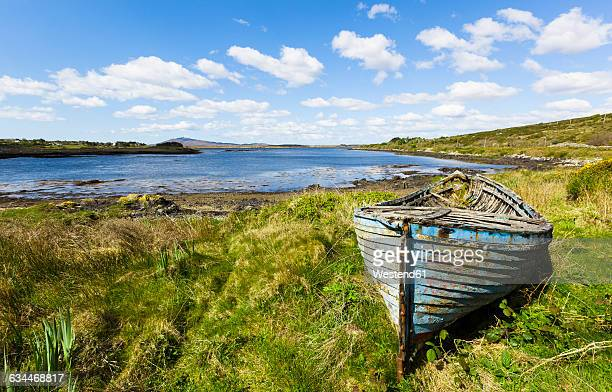 Ireland, Connemara, old boat on water's edge