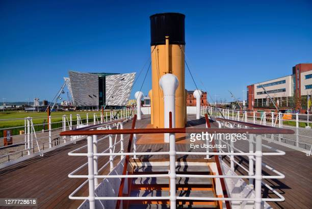 Ireland, County Antrim, Belfast, Titanic Quarter, Titanic Belfast visitor attraction seen from the upper deck of the restored SS Nomadic a former...
