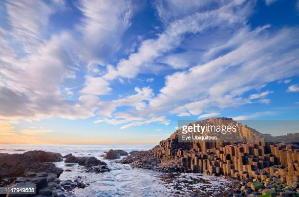 Ireland. County Antrim. Giants Causeway. Dramatic cloud pattern over the rocks at sunset.