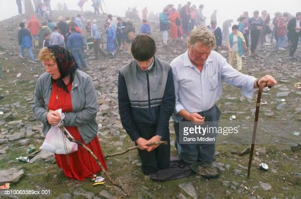 Ireland, County Mayo, people praying at Craogh Patrick
