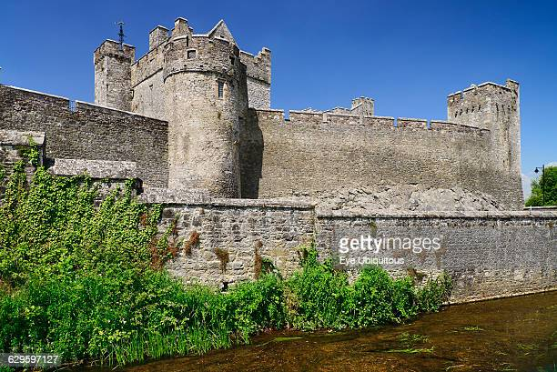 Ireland County Tipperary Cahir Cahir Castle General view of castle and surrounding wall with stream running past