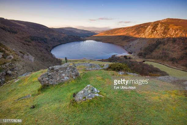 Ireland, County Wicklow, Early morning view of the Wicklow Mountains and Lough Tay including the Luggala Estate which was home to the late Guinness...