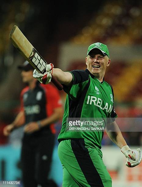 Ireland cricketer Kevin O'Brien celebrates his century during the ICC Cricket World Cup 2011 match between England and Ireland at The M Chinnaswamy...