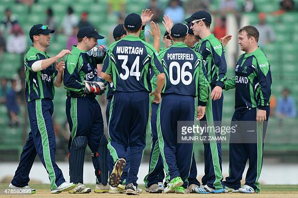 Ireland cricketers celebrate after the dismissal of unseen Bangladesh batsman Anamul Haque during the ICC Twenty20 World Cup warm up cricket match...