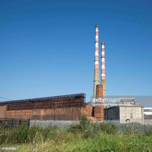 Ireland Dublin Ringsend Poolbeg Power Station and ruins of previous Pigeonhouse Power Station The Poolbeg power plant is a oil and gas fired station...