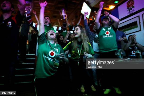 Ireland fans celebrate as they win the NatWest Six Nations Championship after watching England's defeat to France at the Woolshed Baa on March 10...